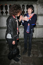 As she lit up a tasty cigarette Ana carried a cute leather quilted tote bag. The bag suited her rocker chic look well.