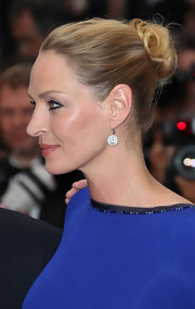 Uma Thurman highlighted her stunning gown by pulling her hair up in a soft bun that was securely pinned into place.