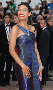 Rosario Dawson topped off her look with diamond and sapphire cocktail rings.