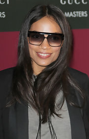 Rosario Dawson wore her hair long and straight with a casual center part at a showjumping event in France.