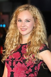 Attending the world premiere of 'Anna Karenina' in London, actress Juno Temple wore her thick blonde hair in masses of natural curls.