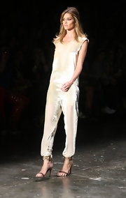 Ana Beatriz Barros modeled this sporty-chic white jumpsuit featuring alternating sheer and silk panels during Sao Paulo Fashion Week.