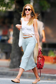 Rosie Huntington-Whiteley wore a pair or tan leather flats with ankle straps while out in NYC.