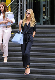Rosie Huntington-Whiteley popped some pastel into her look with a blue leather tote.