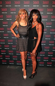 Cathy Guetta wore this tight fit-and-flare dress to the Ranault Twizy launch.