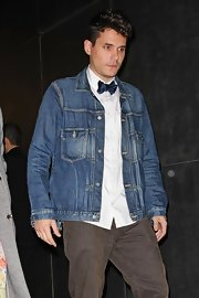 John Mayer dressed down a pristine oxford shirt and bowtie with a rugged denim jacket.