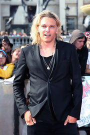 Jamie Campbell Bower oozed rock-star appeal in his all-black ensemble, topped off with a snazzy black blazer.