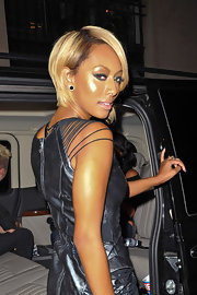To try Keri Hilson's sexy, eye-enhancing look, start by using a deep midnight blue or emerald green eye pencil to heavily line the upper and lower lash lines. Next, with a liner brush, lightly draw out color past the outer corners of the eyes and feather to soften an harsh lines. For the perfect shade, we recommend a product like Urban Decay 24/7 Glide-On Eye Pencil in the color Binge or Covet.