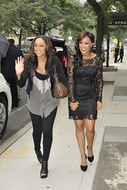 Tamera Mowry, along with sister Tia, greeted fans in a black lace cocktail dress outside the 'Wendy Williams Show.'