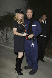 Kathy Hilton vamped it up in a pair of black patent knee-high boots during her daughter's Halloween party.