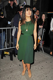 Salma Hayek lightened up her look with these nude platform pumps.