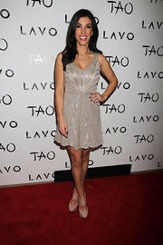 Adrianna Costa kept her glitzy dress the center of attention by pairing it with nude platform pumps with crisscrossing straps.