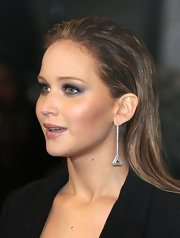 Jennifer Lawrence switched up her red carpet look by slicking back her long light-brown locks for the 2013 BAFTAs.
