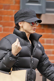 Sandra Bullock went incognito as she made her way through the city in a black canvas cap and a pair of silver mirrored aviators.