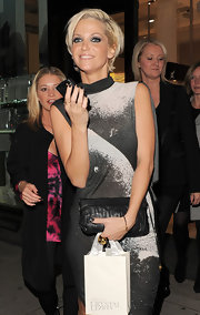 "Sarah Harding shows off her leather pleated clutch at the ""Sparkling night with nick"" event."