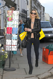 Sarah Harding kept things simple in London with a pair of dark denim skinny jeans and ankle boots.