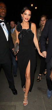 Sarah Harding added glamour to her black evening gown with a pair of nude crystal-embellished strappy sandals.
