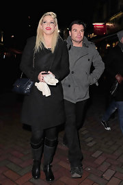 Sarah Harding dressed down her winter look with flat suede and leather boots.