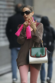 Sarah Jessica Parker embraced the color-block trend with a green, black and white croc and leather Silvana bag.