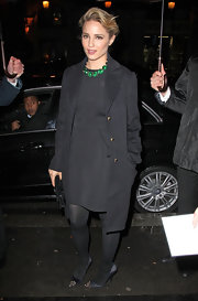 Dianna Agron paired her black sheath with a matching coat.