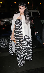 Fan Bingbing never ceases to impress with her playful fashion! For the Louis Vuitton exhibit, she wore this semi-sheer zebra jumpsuit.