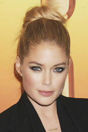 Doutzen Kroes kept it simple with her hair pulled up into a casual bun at the premiere of 'Tower Heist.'