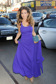 Sarah Jessica Parker complemented her vibrant purple gown with an aqua stingray clutch inlaid with large blue stones.
