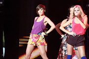 Frankie Sandford danced on stage in a silky violet tank and floral print hot pants.
