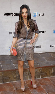 Mila wore a chic patterned ensemble entailing a print mini and sheer button-down blouse for the Spike Awards.