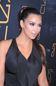 Kim Kardashian arrived at the opening of RYU restaurant in NYC wearing her hair in a long sleek ponytail.