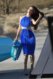 Selena Gomez showed off her feminine curves while on a video shoot, where she stunned in a blue halter dress.