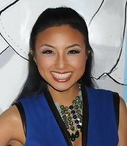 Jeannie Mai kept her hairstyle simple yet pretty with this half-up half-down 'do during Mercedes-Benz Fashion Week.