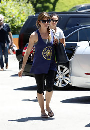 Selma opted for a loose-fitting purple wheel tank for her look while out and about in LA.