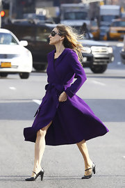 Sarah Jessica Parker strolled through NYC in ladylike black leather ankle strap pumps.
