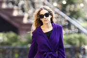 Sensational mum! Sarah Jessica Parker looking pretty in purple takes her son James to school in New York.