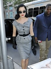 Dita's elbow-length leather gloves are the epitome of luxury.