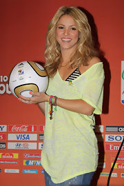 Shakira showed off her signature mane while hitting a press conference for the World Cup.