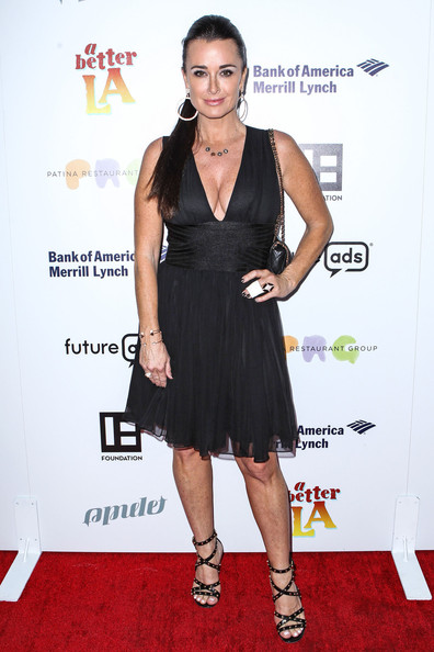 Kyle Richards showed a little skin with this black dress that featured a deep V-neck and a flowing skirt.