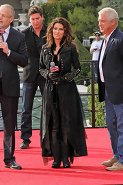 Embellished zip cuffs and heavy hardware put a country twist on Shania's swingy coat.