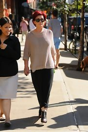 Sharon Osbourne walked around SoHo wearing a knit sweater on top of her black maxi dress.