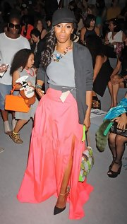 June Ambrose styled her look with a leather python printed shoulder bag at the Tadashi Shoji fashion show.