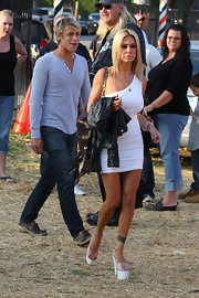 All eyes were on Shauna Sand as she walked about at a pumpkin patch wearing a skimpy white one-shoulder dress.