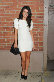 Shenae Grimes gave her feminine frock an asymmetrical finish with a pair of black platform pumps, one one missing ankle strap.