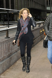 Sheryl Crow added some color to her all black look with a gray and red patterned scarf.