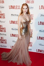 Jessica Chastain arrived at the 'Lawless' premiere wearing a stunning sleeveless blush chiffon evening gown featuring a gathered v-neck, high waist and full skirt embroidered with rectangular metallic bronze, nude and transparent paillettes.
