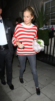 Sienna Miller left the Theatre Royal in a chunky striped jumper from Topshop.