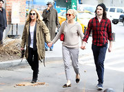Sienna Miller chose this tan crewneck for her casual street style while out in NYC with her mom and boyfriend.