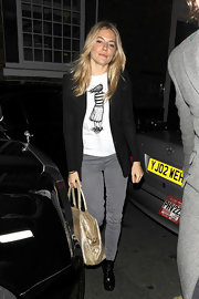 Siena wears a sweet graphic tee under her cardigan for an outing in London.