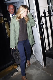 Sienna wears an army green jacket with her skinny blue jeans while out in London.