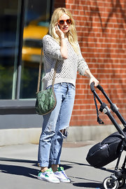 Sienna Miller chose a casual ripped jean, which she rolled at the ankle, for her daytime look while out in the West Village.